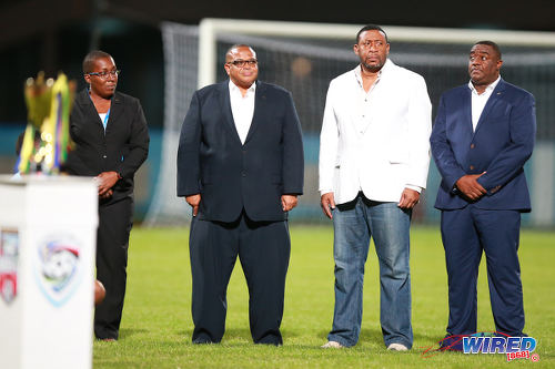 Photo: Caribbean Football Union (CFU) president Gordon Derrick (second from left) is sandwiched by TTFA president David John-Williams (second from right) and TTFA employee Sharon O'Brien (far left) before the CFU Under-17 final on 25 September 2016 at the Ato Boldon Stadium. John-Williams tried unsuccessfully to replace Derrick as CFU president on 23 July 2016. (Courtesy Allan V Crane/Wired868)