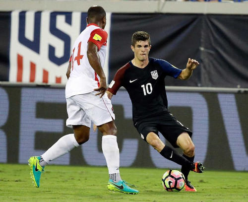 Photo: Then 17-year-old United States midfielder Christian Pulisic (right) takes on Trinidad and Tobago midfielder Andre Boucaud during FIFA 2018 World Cup qualifying action at the EverBank Field on 6 September 2016 in Jacksonville, Florida. (Copyright John Raoux/AP)