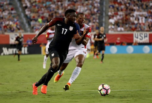 Photo: United States forward Jozy Altidore (left) tries to escape from Trinidad and Tobago defender Carlyle Mitchell during FIFA 2018 World Cup qualifying action at the EverBank Field on 6 September 2016 in Jacksonville, Florida. (Copyright Sam Greenwood/Getty Images/AFP)