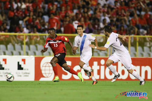 Photo: Trinidad and Tobago winger Cordell Cato (left) sprints past Guatemala left back Rafael Morales (centre) and midfielder Rodrigo Saravia during 2018 World Cup qualifying action at the Hasely Crawford Stadium, Port of Spain on 2 September 2016. Trinidad and Tobago and Guatemala played to a 2-2 draw. (Courtesy Chevaughn Christopher/Wired868)