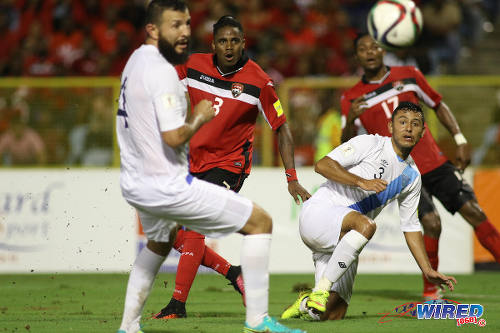 Photo: Trinidad and Tobago winger Joevin Jones (centre) steers home his second goal while Guatemala defenders Christian Jimenez (right) and Hamilton Lopez look on during Russia 2018 World Cup qualifying action at the Hasely Crawford Stadium, Port of Spain on 2 September 2016. Jones struck twice in a 2-2 draw between the two nations. (Courtesy Chevaughn Christopher/Wired868)