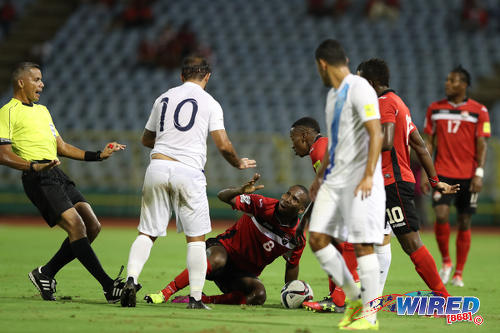 Photo: Referee John Patti (far left) tries to calm things down as Trinidad and Tobago midfielder Khaleem Hyland (centre) remonstrates with Guatemala playmaker Jose Contreras (second from left) during 2018 World Cup qualifying action at the Hasely Crawford Stadium, Port of Spain on 2 September 2016. (Courtesy Allan V Crane/CA-Images/Wired868)