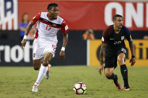 Photo: Trinidad and Tobago defender Mekeil Williams (left) races past United States defender Geoff Cameron during World Cup qualifying action on 6 September 2016 at EverBank Field, Jacksonville, Florida. (Copyright Logan Bowles/USA TODAY)