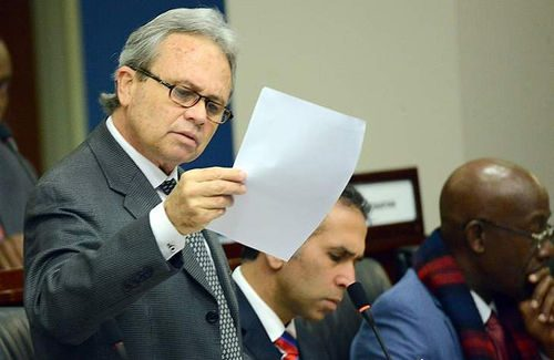Photo: Finance Minister Colm Imbert responds to questions in Parliament.. (Copyright WEFM)