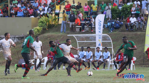 Photo: Morvant Caledonia United captain Akim Armstrong (centre) tries to hold off San Juan Jabloteh defender Aquil Selby (second from left) while Jevon Morris (right) looks on during Pro League action at the Morvant Recreation Ground on 16 October 2016. (Courtesy Sean Morrison/Wired868)