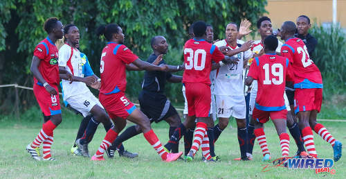 Photo: Morvant Caledonia United veteran and ex-Trinidad and Tobago 2006 World Cup player Densill Theobald (centre, white shirt) finds himself in the middle of a brawl during Pro League action against St Ann's Rangers at the Barataria Recreation Ground on 9 October 2016. Refee Keilon Bacchus (fourth) from left ejected Morvant Caledonia attacker Jameel Neptune and Rangers defender Shakiyl Phillip once the dust had settled. (Courtesy Sean Morrison/Wired868)