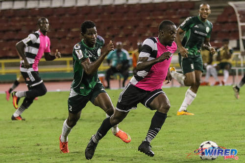 Photo: Central FC attacker Marcus Joseph (right) tries to pull away from W Connection winger Kurt Frederick during 2016/17 Pro League action at the Hasely Crawford Stadium in Port of Spain on 4 October 2016. (Courtesy Sean Morrison/Wired868)
