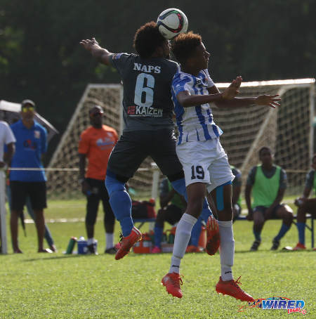 Photo: Naparima College midfielder Judah St Louis (left) challenges St Mary's College forward Trey La Motte in the air during SSFL Premier Division action at Serpentine Road on 8 October 2016. (Courtesy Sean Morrison/Wired868)