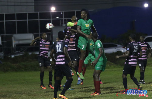 Photo: San Juan Jabloteh forward Jamal Gay (centre) diverts a corner kick past Ma Pau Stars goalkeeper Glenroy Samuel during Pro League action at the Barataria Recreation on 23 October 2016. Jabloteh won 1-0. (Courtesy Sean Morrison/Wired868)