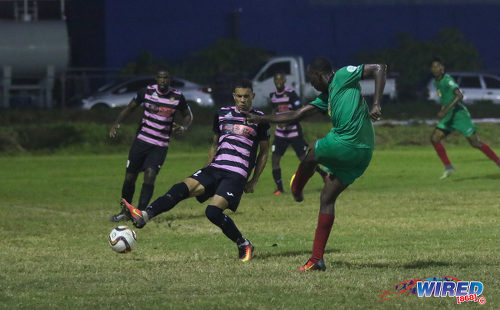 Photo: San Juan Jabloteh full back Noel Williams (right) fires past Ma Pau Stars right back Carlos Edwards during Pro League action at the Barataria Recreation on 23 October 2016. (Courtesy Sean Morrison/Wired868)
