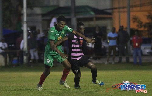 Photo: San Juan Jabloteh striker Willis Plaza (left) challenges Ma Pau Stars midfielder Elton John during Pro League action at the Barataria Recreation on 23 October 2016. (Courtesy Sean Morrison/Wired868)