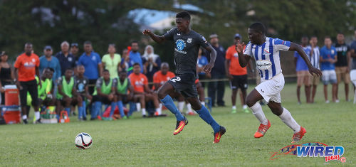 Photo: Naparima College attacker Isaiah Lee (left) takes on St Mary's College defender Nathan Harte during SSFL Premier Division action at Serpentine Road on 8 October 2016. (Courtesy Sean Morrison/Wired868)