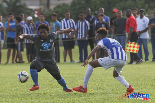 Photo: Naparima College midfielder Judah St Louis (left) takes on St Mary's College forward Trey La Motte during SSFL Premier Division action at Serpentine Road on 8 October 2016. (Courtesy Sean Morrison/Wired868)