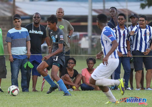 Photo: Naparima College midfielder Justin Sadoo (left) races down the byline during SSFL Premier Division action against St Mary's College at Serpentine Road on 8 October 2016. (Courtesy Sean Morrison/Wired868)