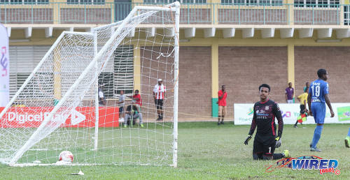 Photo: Naparima College goalkeeper Levi Fernandez looks back in despair after another St Anthony's College goal during SSFL Premier Division action at Westmoorings on 15 October 2016. (Courtesy Sean Morrison/Wired868)