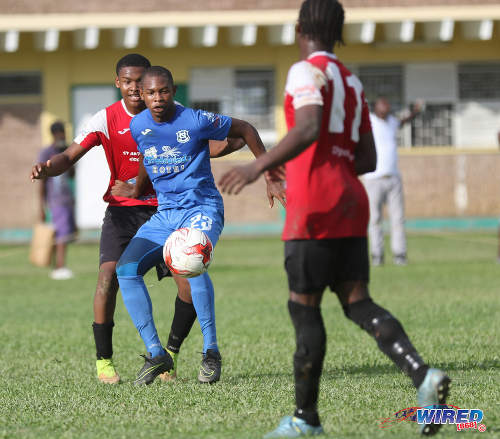 Photo: Naparima College midfielder Renaldo Francois (centre) holds off a St Anthony's College opponent during SSFL Premier Division action at Westmoorings on 15 October 2016. (Courtesy Sean Morrison/Wired868)