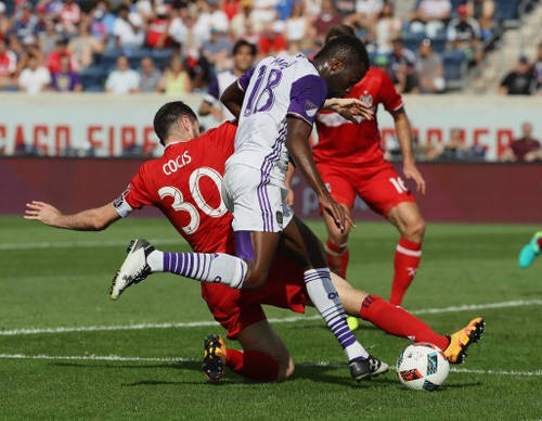 Photo: Chicago Fire defender Razvan Cocis (left) slides in to a shot by Orlando City midfielder Kevin Molino during an MLS match at Toyota Park on 14 August 2016 in Bridgeview, Illinois. The Fire and Orlando City SC tied 2-2. (Copyright AFP 2016/Jonathan Daniel/Getty Images)