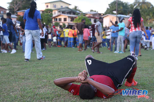 Photo: A Pleasantville Secondary player (foreground) laments the final result after a 3-1 defeat to Shiva Boys Hindu College in SSFL Premier Division action in Pleasantville on 22 October 2016. (Courtesy Chevaughn Christopher/Wired868)