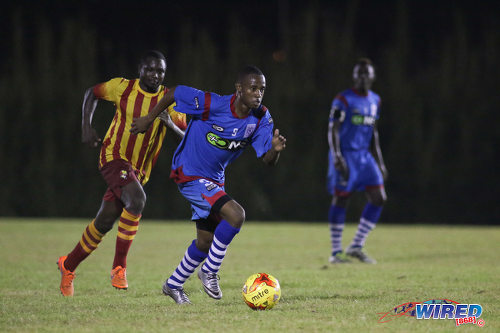 Photo: St Ann's Rangers winger Jomoul Francois (right) accelerates while Point Fortin Civic attacker Sylvester Teesdale looks on during Pro League action on 30 October 2016 at Mahaica Oval. (Courtesy Chevaughn Christopher/Wired868)