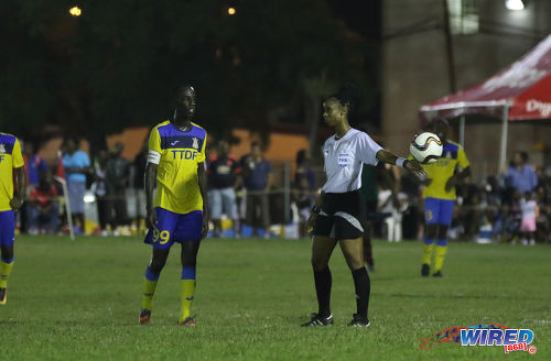 Photo: Referee Crystal Sobers (right) drops the ball for Defence Force captain Jerwyn Balthazar during Pro League action against San Juan Jabloteh at the Barataria Recreation Ground on 9 October 2016. (Courtesy Sean Morrison/Wired868)