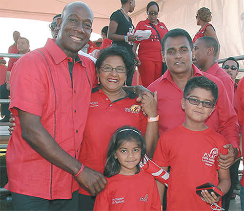 Photo: Prime Minister Dr Keith Rowley (far left) poses with PNM deputy political leader Rohan Sinanan (right) and his family. (Copyright Trinidad Guardian)