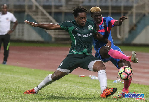 Photo: Club Sando winger Akeem Roach (right) tries to escape from W Connection defender Maurice Ford during Pro League action at the Ato Boldon Stadium in Couva on 14 October 2016. (Courtesy Sean Morrison/Wired868)