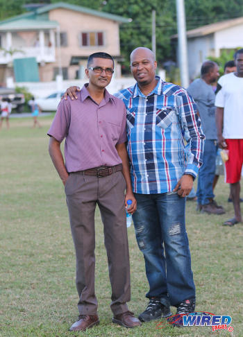 Photo: Shiva Boys Hindu College principal Dexter Saklal (left) poses with a football supporter during SSFL Premier Division action against St Mary's College at Lachoo Road on 19 October 2016. (Courtesy Sean Morrison/Wired868)