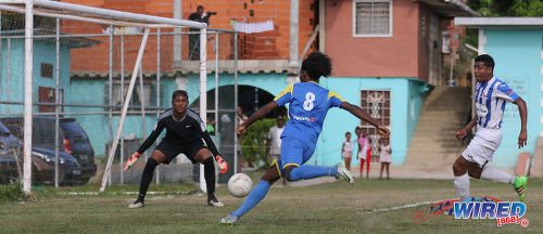 Photo: Shiva Boys Hindu College attacker Junior Asson (centre) prepares to fire at goal while St Mary's College goalkeeper Jordan Bidaisee (left) and defender Emilio Saunders look on during SSFL Premier Division action at Lachoo Road on 19 October 2016. (Courtesy Sean Morrison/Wired868)