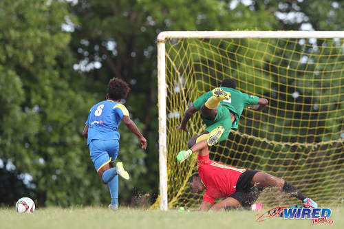 Photo: Shiva Boys Hindu College striker Junior Asson (left) prepares to finish as Signal Hill defender Jokiah Leacock (right) collides with his own goalkeeper during SSFL Premier Division action in Tobago on 5 October 2016. (Courtesy Allan V Crane/CA Images/Wired868)