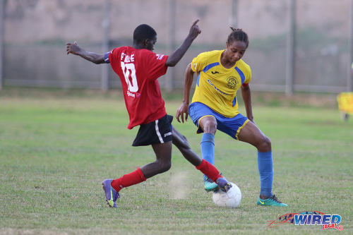 """Photo: Shiva Boys Hindu College stand-in captain Tyrel """"Pappy"""" Emmanuel (right) and Pleasantville Secondary captain Jude Phillip contest the ball during SSFL Premier Division action on 22 October 2016. (Courtesy Chevaughn Christopher/Wired868)"""
