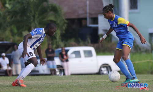 """Photo: Shiva Boys Hindu College stand-in captain Tyrel """"Pappy"""" Emmanuel (right) takes on St Mary's College defender Nathan Harte during SSFL Premier Division action at Lachoo Road on 19 October 2016. (Courtesy Sean Morrison/Wired868)"""