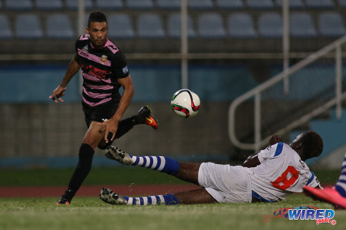 Photo: Ma Pau Stars right back Carlos Edwards (left) gets past St Ann's Rangers defender Jameel Antoine during Pro League action at the Ato Boldon Stadium on 18 October 2016. (Courtesy Chevaughn Christopher/Wired868)