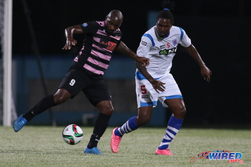 Photo: St Ann's Rangers defender Devon Drayton (right) keeps an eye on Ma Pau Stars forward Jason Scotland during Pro League action at the Ato Boldon Stadium on 18 October 2016. (Courtesy Chevaughn Christopher/Wired868)