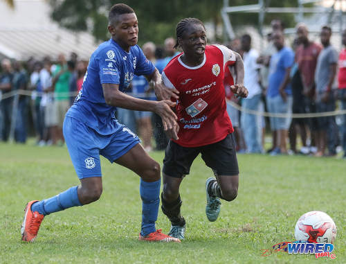 Photo: St Anthony's College midfielder Haile Beckles (right) tries to escape from a Naparima College opponent during SSFL Premier Division action at Westmoorings on 15 October 2016. (Courtesy Sean Morrison/Wired868)