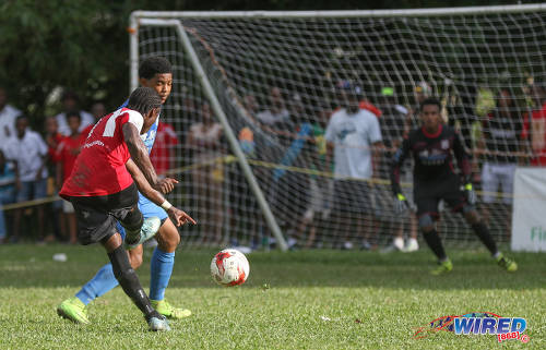 Photo: St Anthony's College midfielder Haile Beckles (left) shoots for goal during SSFL Premier Division action against Naparima College at Westmoorings on 15 October 2016. (Courtesy Sean Morrison/Wired868)