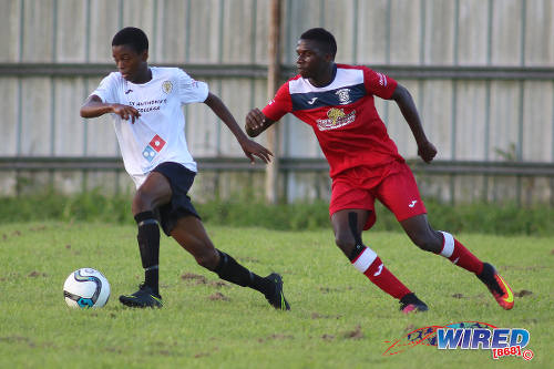 Photo: St Anthony's College and Trinidad and Tobago National Under-17 Team winger Tyrese Bailey (left) in action against Fyzabad Secondary on 24 September 2016. (Courtesy Chevaughn Christopher/Wired868)