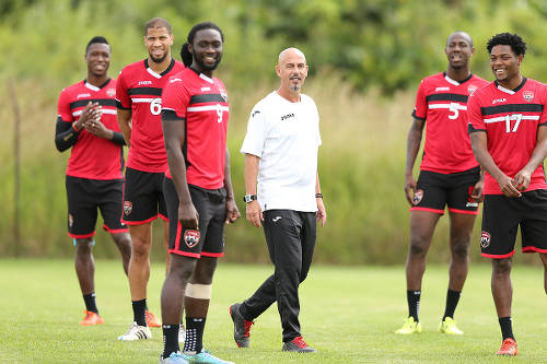 Photo: Trinidad and Tobago National Senior Team coach Stephen Hart (centre) and players (from right) Mekeil Williams, Daneil Cyrus, Kenwyne Jones, Radanfah Abu Bakr and Sheldon Bateau at a national training session. (Courtesy KJ Media)