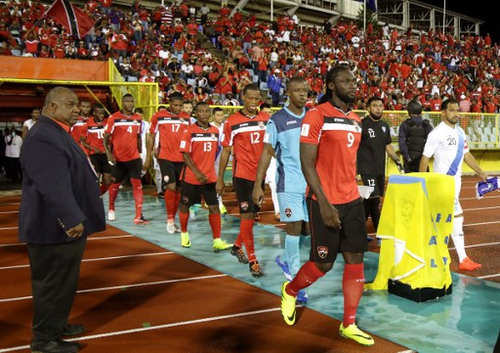 Photo: The Trinidad and Tobago National Senior Team heads to the playing field for World Cup qualifying action against Guatemala at the Hasely Crawford stadium in Port-of-Spain on 2 September 2016. (Copyright AFP 2016/Alva Viarruel)