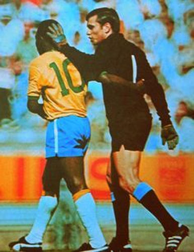 "Photo: Uruguay goalkeeper Ladislao ""El Chiquito"" Mazurkiewicz (right) exchanges pleasantries with Brazil icon Pelé during the 1970 World Cup semifinals."