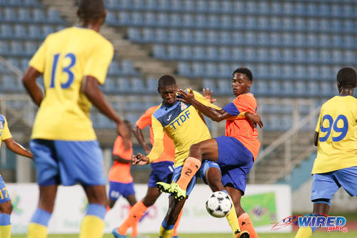 Photo: Defence Force playmaker Hashim Arcia (centre) holds off a Club Sando opponent during First Citizens Cup qualifying action at the Ato Boldon Stadium in Couva on 8 November 2016. (Courtesy Chevaughn Christopher/Wired868)