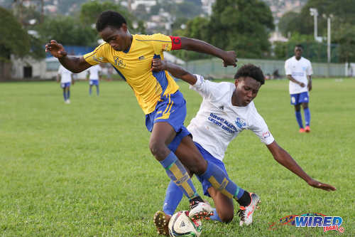 Photo: Diego Martin North Secondary player Teon Pierre (right) tackles Blanchisseuse Secondary captain Trilon Kirk during North Zone Intercol action at the St Mary's College ground in St Clair on 2 November 2016. (Courtesy Sean Morrison/Wired868)