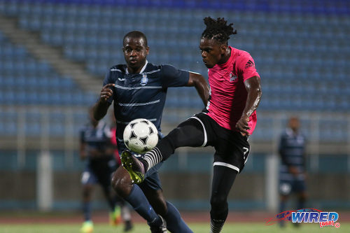 Photo: Central FC attacker Jason Marcano (right) controls the ball under pressure by Police FC defender Elijah Belgrave during Pro League action at the Ato Boldon Stadium on 4 November 2016. (Courtesy Chevaughn Christopher/Wired868)