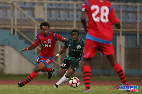 Photo: W Connection attacker Daniel Diaz (centre) is followed by St Ann's Rangers winger Josh Toussaint (left) during Pro League action at the Ato Boldon Stadium on 4 November 2016. (Courtesy Chevaughn Christopher/Wired868)