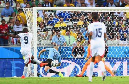 Photo: Costa Rica striker Joel Campbell (left) drives home against Uruguay at the 2014 World Cup. (Copyright Daily Star)