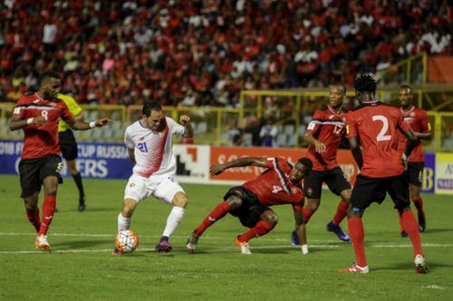 Photo: Costa Rica forward Marcos Ureña (second from left) and Trinidad and Tobago defender Sheldon Bateau (centre) vie for the ball during their 2018 World Cup qualifier football match in Port of Spain, on 11 November 2016. (Copyright AFP 2016/Alva Viarruel)