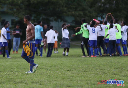 Photo: Diego Martin North Secondary players enjoy the thrill of victory while, in the foreground, a Blanchisseuse Secondary schoolboy tastes the agony of defeat in North Zone Intercol action at the St Mary's College ground in St Clair on 2 November 2016. (Courtesy Sean Morrison/Wired868)