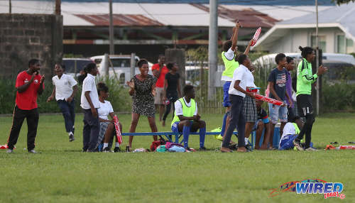 Photo: Diego Martin North Secondary substitutes and supporters react to an early goal by their school during North Zone Intercol action against Blanchisseuse Secondary at the St Mary's College ground in St Clair on 2 November 2016. (Courtesy Sean Morrison/Wired868)