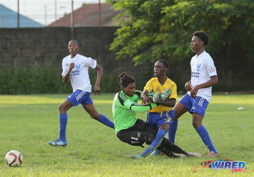 Photo: Diego Martin North Secondary goalkeeper Josiah Cooke (centre) crashes into a Blanchisseuse Secondary player during North Zone Intercol action at the St Mary's College ground in St Clair on 2 November 2016. (Courtesy Sean Morrison/Wired868)