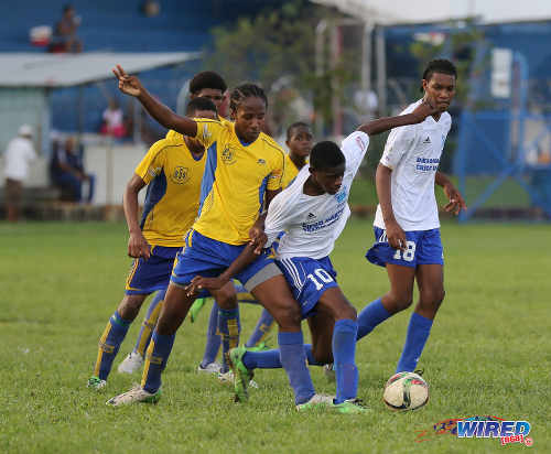 "Photo: Diego Martin North Secondary midfielder Zion ""Bandy"" Williams (centre) tries to escape from a Blanchisseuse Secondary opponent during North Zone Intercol action at the St Mary's College ground in St Clair on 2 November 2016. (Courtesy Sean Morrison/Wired868)"