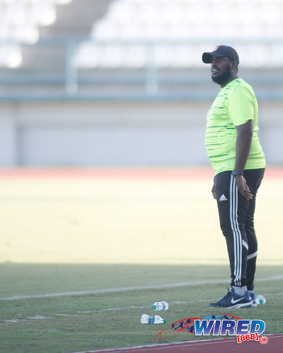 Photo: St Augustine Secondary coach Adrian Romain looks on during the East Zone Intercol final against San Juan North Secondary at the Larry Gomes Stadium, Malabar on 21 November 2016. (Courtesy Annalicia Caruth/Wired868)